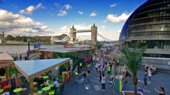 Sport and leisure are next to Tower Bridge and City hall on a sunny day. Stock Footage