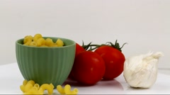 Rotating Cavatappi pasta in a bowl  with tomatoes Stock Footage