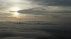 Zoom Out Aerial misty foggy sunrise  KL Cityscape Stock Footage