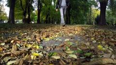 Man Walking On Fallen Leaves Stock Footage