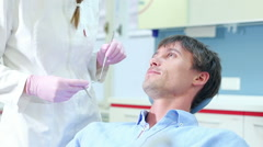 Close up of attractive man having dental examination of aching tooth Stock Footage