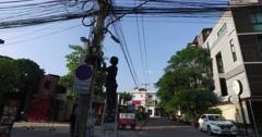 4k - thai man repairing internet line Stock Footage