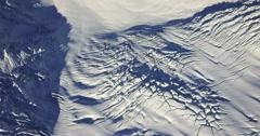Jagged Icefall Glacier Crevasses Aerial Rotation 2K Stock Footage
