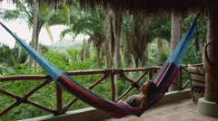 Woman Relax Hammock Jungle Ecolodge Resort Bungalow 5K HD Stock Video Footage Stock Footage