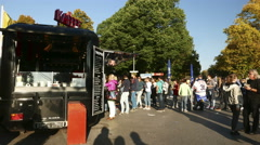 4K German people queue up buying Crepes vendor at Olympia Park Munich Germany Stock Footage