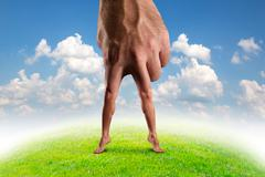 Male hand with legs Stock Photos