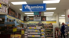 Motion of vitamins sign and display health foods inside London drugs store Stock Footage