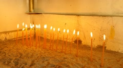 Lighting Votive candles in an old church Stock Footage