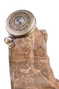 Pocket watch on rock Stock Photos