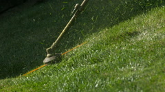 Gas Weed Eater Trimmer Cutting Grass in Slow Motion Stock Footage