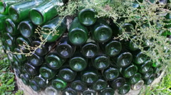 Original flowerbed of glassbottles Stock Footage