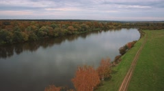 Aerial shot autumn landscape forest, road and river Stock Footage