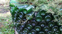 Original flowerbed of glassbottles Stock Footage