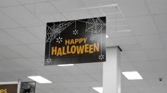Motion of happy halloween sign inside Walmart store Stock Footage