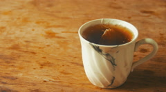 Cup with Tea on a Wooden Table Stock Footage