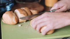 Hands cutting bread Stock Footage