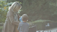 BOY AND GRANDMA IN THE PARK Stock Footage