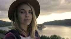 Portrait Of Young Woman At An Overlook With River In Background Stock Footage