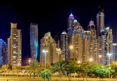 Skyscrapers in Dubai Marina at night. Kuvituskuvat