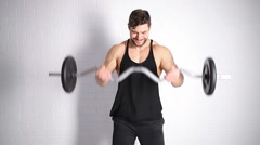 Strong man doing exercise with dumbbells Stock Footage