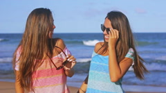 Cool Happy Twin Sisters Smiling and Wearing Sunglasses At The Beach Slow Motion Stock Footage