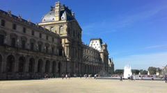 People Are Photographed Against The Backdrop Of The Louvre Museum  Stock Footage