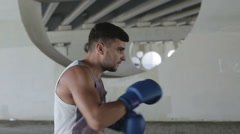 Close up. Boxer is on a training outdoors on background of gray concrete wall. Stock Footage