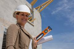 Engineer woman works on a construction site Stock Photos