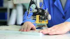 Female worker cutting templates Stock Footage