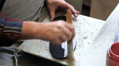 Man at work repairing shoe Stock Footage
