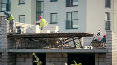 Construction mason workers bricklayer installing white brick with trowel putty Stock Footage