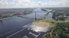 Riga drone aerial flyby Valsu Tilts bridge over Daugava river Stock Footage