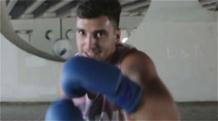Slow motion. Close-up. Boxer in blue gloves. Train fast punching. Boxing concept Stock Footage