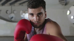 Young caucasian boxer in red gloves is expecting a fight. Stock Footage