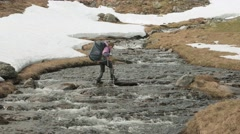 Young girl walks through the mountain river. Norway. Stock Footage