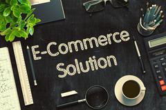 E-Commerce Solution on Black Chalkboard. 3D Rendering Stock Illustration