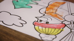 Kid diligently gouache paints a snowman Stock Footage