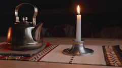 Kettle and candle on the table in Norwegian camp. Stock Footage