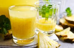 Pineapple cocktail with pulp Stock Photos