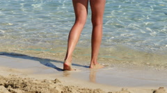 Tanned sexy legs on the beach Stock Footage