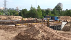 Workers brigade constructing highway viaduct with heavy industry machinery Stock Footage