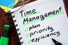 Time Management written on a tablet. Business concept. Stock Photos
