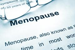 Menopause written on a paper. Medical concept. Stock Photos