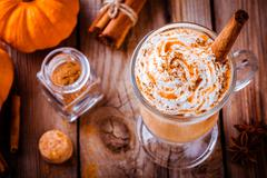 Pumpkin spice latte with whipped cream and caramel Stock Photos
