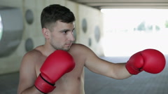 Boxing workout. The guy in a red boxing gloves standing outdoors. Stock Footage