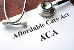 Words Affordable Care Act  ACA written on a paper. Kuvituskuvat