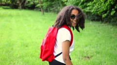 Mixed race African American girl teenager female young woman hiking Stock Footage