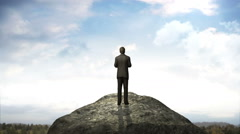Breaks the wall. Businessman standing at the edge of cliff. blue sky. Stock Footage