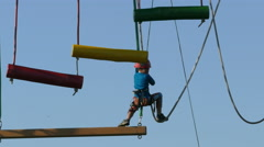 4K German Kid boy balancing climbing sport in air Olympia park Munich Germany  Stock Footage