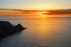 Beautiful serene sunset over loop head Kuvituskuvat